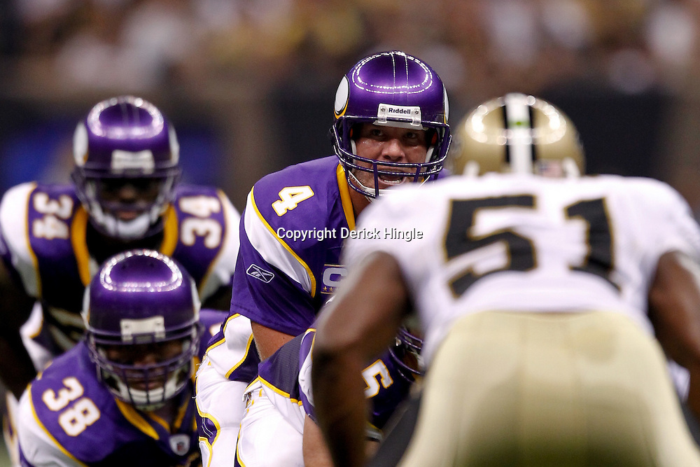 September 9, 2010; New Orleans, LA, USA; Minnesota Vikings quarterback Brett Favre (4) under center against the New Orleans Saints during the NFL Kickoff season opener at the Louisiana Superdome. The New Orleans Saints defeated the Minnesota Vikings 14-9.  Mandatory Credit: Derick E. Hingle