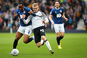 Derby County midfielder Louie Sibley in a tussle for the ball with Blackburn Rovers defender Ryan Nyambe during the EFL Sky Bet Championship match between Derby County and Blackburn Rovers at the Pride Park, Derby, England on 8 March 2020.