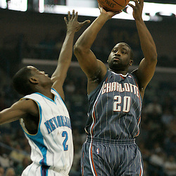 Apr 07, 2010; New Orleans, LA, USA; Charlotte Bobcats guard Raymond Felton (20) shoots over New Orleans Hornets guard Darren Collison (2) during the first half at the New Orleans Arena. Mandatory Credit: Derick E. Hingle-US PRESSWIRE