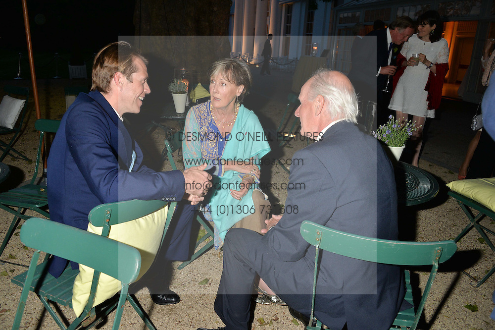 Left to right, BEN ELLIOT and CHARLES & PATTI PALMER TOMKINSON at a dinner hosted by Cartier in celebration of The Chelsea Flower Show held at The Hurlingham Club, London on 19th May 2014.