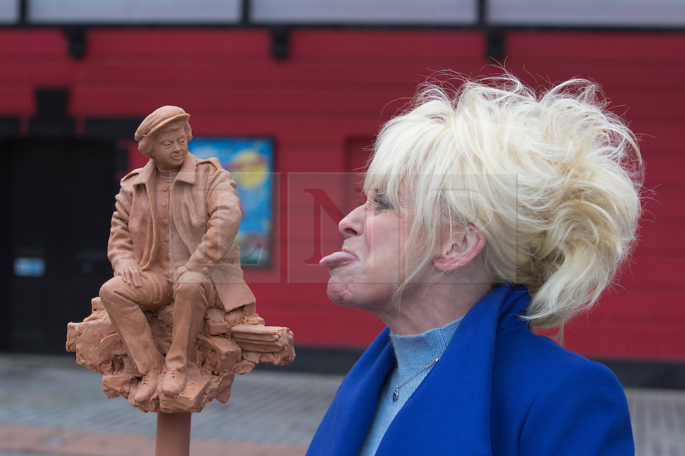 © Licensed to London News Pictures. 21/11/2013. London, England. Barbara Windor lovingly sticks out her tongue at her old friend Joan Littlewood. Barbara Windsor has joined Theatre Royal Stratford East's fundraising campaign to build a sculpture for the legendary director Joan Littlewood with whom she worked during the early stages of her career. The theatre launches a public appeal to raise the final 40% needed (c. £60,000) to commission Philip Jackson to created the bronze sculpture which is due to be installed in Theatre Square, Stratford in spring 2014. Photo credit: Bettina Strenske/LNP