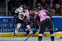 KELOWNA, CANADA - OCTOBER 21: Brendan De Jong #21 of the Portland Winterhawks checks Ted Brennan #10 of the Kelowna Rockets at the boards on October 21, 2017 at Prospera Place in Kelowna, British Columbia, Canada.  (Photo by Marissa Baecker/Shoot the Breeze)  *** Local Caption ***