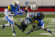 Little Rock Central's Gavin Vincenski knocks the helmet off of North Little Rock defender during the second quarter of their game at War Memorial Stadium in Little Rock on November 6, 2014/