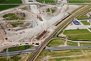 Nederland, Friesland, Leeuwarden, 01-05-2013; aanleg N31 de Haak om Leeuwarden. Nieuwe spoorkruising en aansluiting lokale wegen, bedrijventerrein Newtonpark .De nieuwe rijksweg vormt de verbinding tussen de huidige A31 bij Marsum en de N31 bij Hemriksein (Wâldwei)..Construction site of new motorway junction of the N31 near Leeuwarden, crossing the railway (detail).  .luchtfoto (toeslag op standard tarieven).aerial photo (additional fee required).copyright foto/photo Siebe Swart