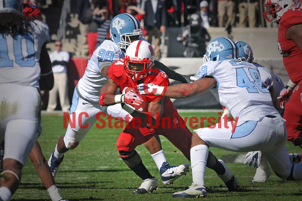 Halfback James Washington hits a hole for extra yardage against the Heels.