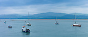Sailing boats moored in Dyfi estuary at Aberdyfi, Aberdovey, Snowdonia, Wales