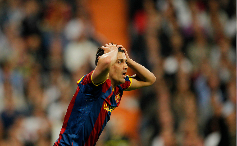 Barcelona's David Villa, reacts during his Spanish La Liga soccer match against Real Madrid at the Santiago Bernabeu stadium in Madrid, Saturday, April 16, 2011.