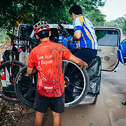 Mr. Sak loads the bikes after a ride in the single track through the jungle near Chiang Dao, Thailand.