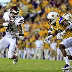 Sep 17, 2016; Baton Rouge, LA, USA;  Mississippi State Bulldogs running back Aeris Williams (27) runs as LSU Tigers cornerback Tre'Davious White (18) pursues during the second half of a game at Tiger Stadium. LSU defeated Mississippi State 23-20. Mandatory Credit: Derick E. Hingle-USA TODAY Sports