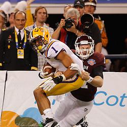 Jan 7, 2011; Arlington, TX, USA; LSU Tigers cornerback Eric Reid (1) is tackled following an interception by Texas A&M Aggies quarterback Ryan Tannehill (17) during the second quarter of the 2011 Cotton Bowl at Cowboys Stadium.  Mandatory Credit: Derick E. Hingle