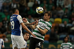 April 18, 2018 - Lisbon, Portugal - Sporting's defender Sebastian Coates from Uruguay (R ) vies with Porto's Brazilian forward Soares during the Portugal Cup semifinal second leg football match Sporting CP vs FC Porto at the Alvalade stadium in Lisbon on April 18, 2018. (Credit Image: © Pedro Fiuza via ZUMA Wire)