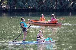 © Licensed to London News Pictures. 07/08/2020. London, UK. Kayakers enjoy the River Thames Richmond in South West London as temperatures are expected to reach to 35c today. Thousands of sun seekers have flocked to parks, rivers and the south coast as temperatures soar with beaches and roads becoming jammed with holidaymakers. The heat is set to continue for the rest of the week with temperatures expected in the high 20s. Photo credit: Alex Lentati/LNP