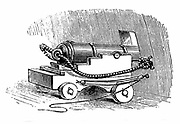 Ship cannon on gun carriage, showing gun-tackle, blocks and pulleys fixed to sides of gun-carriage and to side of ship, by means of which gun is run up to, or drawn back from porthole. Wood engraving, 1884.