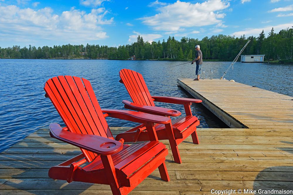 Fishing and Muskoka chairs - Star Lake<br />Whiteshell Provincial Park<br />Manitoba<br />Canada