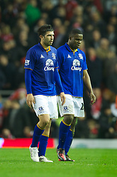 LIVERPOOL, ENGLAND - Tuesday, March 13, 2012: Everton's Denis Stracqualursi and Victor Anichebe walk off dejected as their side trail Liverpool 1-0 at half-time during the Premiership match at Anfield. (Pic by David Rawcliffe/Propaganda)