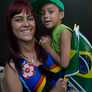 Brazilian family from Bahia, mother holding son showing their ethnic and cultural pride.