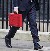 © Licensed to London News Pictures. 18/03/2015. Westminster, UK British Prime Chancellor George Osborne with his red ministerial box leaves Downing Street on the day of the spring budget 2015. Photo credit : Stephen Simpson/LNP