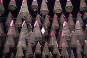 October 2003 - Ho Chi Minh City - Spiral incense hangs inside a Chinese temple.<br /> Photo Credit: Luke Duggleby