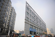 JINAN, CHINA - NOVEMBER 17: (CHINA OUT) <br /> <br /> Thin Building Like A Piece Of Paper<br /> <br /> An office building looks like a piece of paper on November 17, 2015 in Jinan, Shandong Province of China. The 5-story office building with a 20-centimeter-wide east corner looked like a piece of paper at a distance in Jinan.<br /> ©Exclusivepix Media