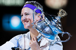 © Licensed to London News Pictures. 26/01/2013. Melbourne Park, Australia. Victoria Azarenka holds up her winner trophy while smiling  during the Womens Final between Victoria Azarenka and Li Na of the Australian Open. Photo credit : Asanka Brendon Ratnayake/LNP