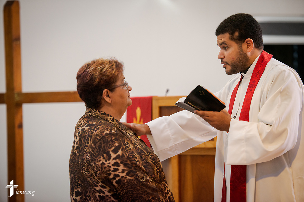 Sylvia Gonzalez is confirmed by the Rev. Gustavo Maita, pastor of Iglesia Luterana Principe de Paz (Prince of Peace Lutheran Church), Mayagüez, Puerto Rico, during worship on Sunday, April 15, 2018. LCMS Communications/Erik M. Lunsford