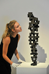 """© Licensed to London News Pictures. 12/10/2017. London, UK.  A staff member views """"Small Charge"""", 2015, by Antony Gormley (Est. GBP120-180k) at a preview of artworks for the """"Art for Grenfell"""" auction taking place at Sotheby's, New Bond Street, on 16 October.  Leading contemporary artists have agreed to donate works to the auction, the proceeds of which will be divided equally amongst the 158 surviving families of the Grenfell Tower fire by the Rugby Portobello Trust charity. Photo credit : Stephen Chung/LNP"""