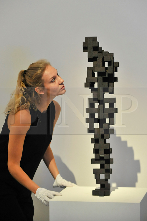 "© Licensed to London News Pictures. 12/10/2017. London, UK.  A staff member views ""Small Charge"", 2015, by Antony Gormley (Est. GBP120-180k) at a preview of artworks for the ""Art for Grenfell"" auction taking place at Sotheby's, New Bond Street, on 16 October.  Leading contemporary artists have agreed to donate works to the auction, the proceeds of which will be divided equally amongst the 158 surviving families of the Grenfell Tower fire by the Rugby Portobello Trust charity. Photo credit : Stephen Chung/LNP"