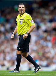LONDON, ENGLAND - Sunday, August 31, 2014: Referee Phil Dowd, showing a rotund figure, during the Premier League match between Tottenham Hotspur and Liverpool at White Hart Lane. (Pic by David Rawcliffe/Propaganda)