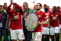 Manchester United win the FA Community Shield beating Leicester City 2-1, Daley Blind of Manchester United holds the shield - Mandatory byline: Jason Brown/JMP - 07966386802 - 07/08/2016 - FOOTBALL - Wembley Stadium - London, England - Leicester City v Manchester United - FA Community Shield