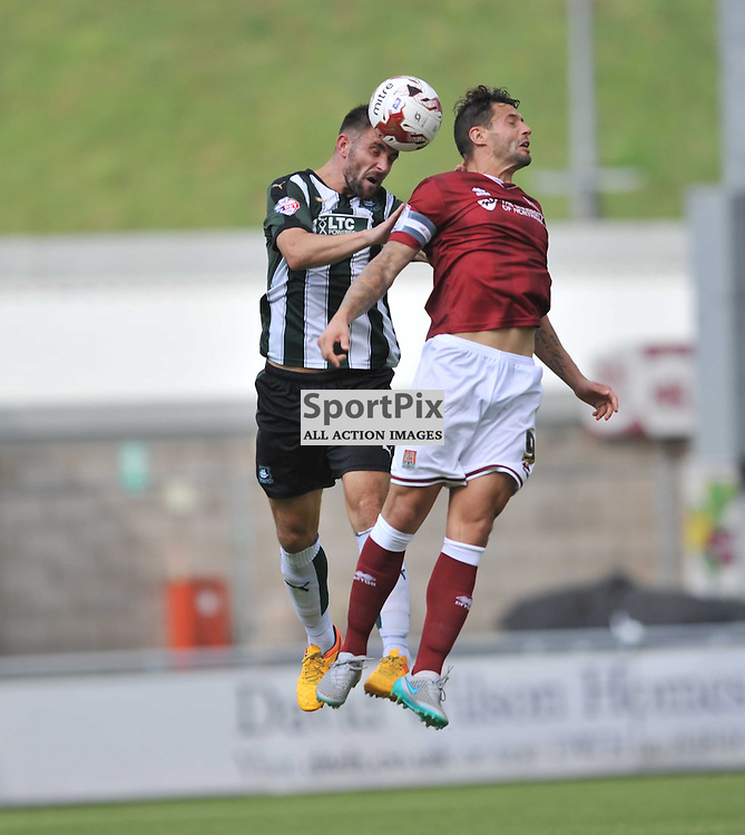 Plymouths Peter Hartley holds of Northamptons Marc Richards, Northampton Town v Plymouth Argyle, Sky Bet League 2, Saturday 22/8/2015