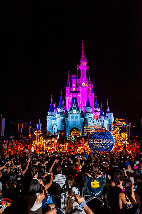 Disney's Electrical Parade (with Cinderella Castle in back), Magic Kingdom, Walt Disney World, Orlando, Florida USA