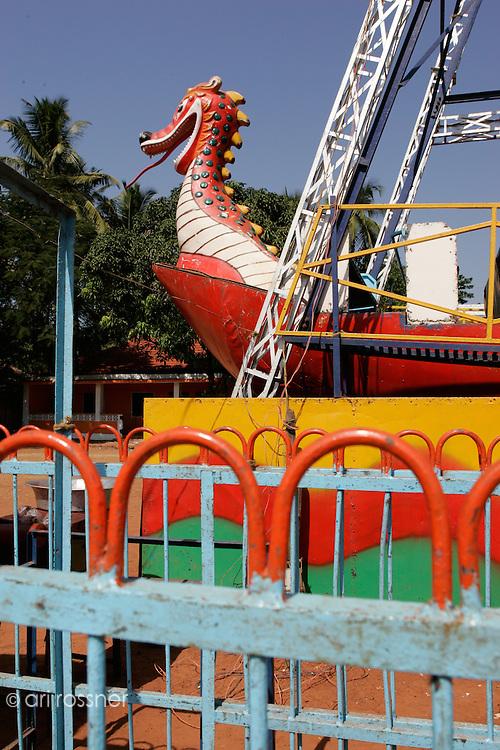 Funfair with a big dragon carousel