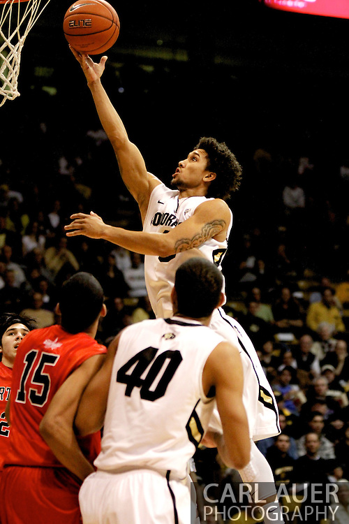 December 29, 2012: Colorado Buffaloes sophomore guard ASKIA BOOKER (0) rises above the rest for a lay up in the NCAA Basketball game between the University of Hartford Hawks and the Colorado Buffaloes at the Coors Event Center in Boulder Colorado