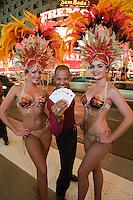 Man and female dancers having fun