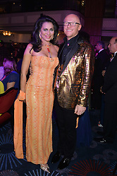 LADY WILNELIA FORSYTH and JOHN CAUDWELL at the Caudwell Children's annual Butterfly Ball held at The Grosvenor House Hotel, Park Lane, London on 15th May 2014.