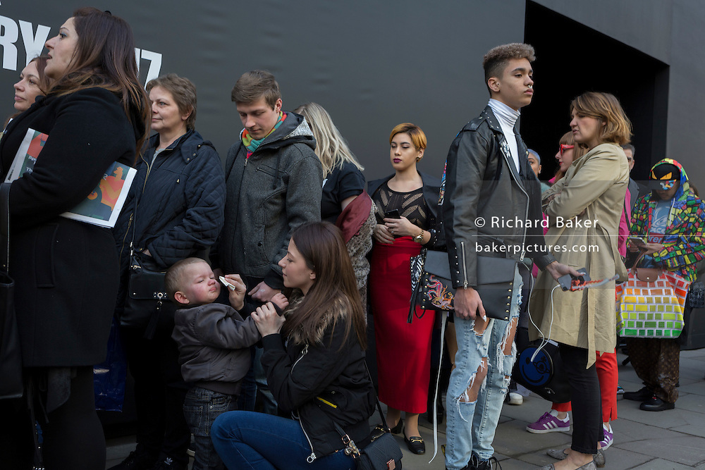 """A child cries while queueing outisde London Fashion Week in the Strand, on 17th Febriary 2017, in London, England, United Kingdom. London Fashion Week is a clothing trade show held in London twice each year, in February and September. It is one of the """"Big Four"""" fashion weeks, along with the New York, Milan and Paris. The fashion sector plays a significant role in the UK economy with London Fashion Week alone estimated to rake in £269 million each season. The six-day industry event allows designers to show their collections to buyers, journalists and celebrities and also maintains the city's status as a top fashion capital. (Photo by Richard Baker / In Pictures via Getty Images)"""
