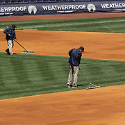 Ground staff preparing the infield before  the New York Yankees V Chicago Cubs, double header game one at Yankee Stadium, The Bronx, New York. 16th April 2014. Photo Tim Clayton