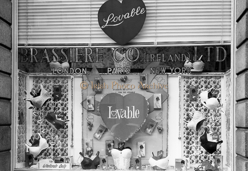 'It Costs So Little To Look So Lovable' proclaims the sign over the Lovable Bras display in the Brassiere Co. window. .18.11.1966