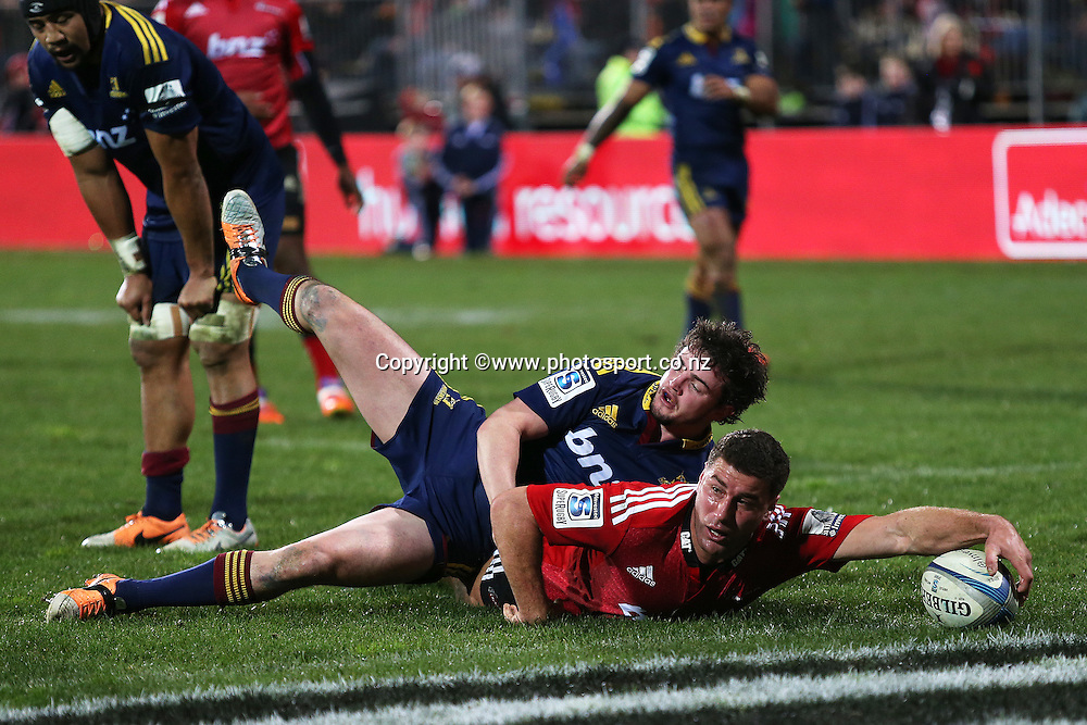 Kieron Fonotia of the Crusaders is tackled by Richard Buckman of the Highlanders in an unawarded try during the Investec Super Rugby game between Crusaders v Highlanders at AMI Stadium, Christchurch. 12 July 2014 Photo: Joseph Johnson/www.photosport.co.nz