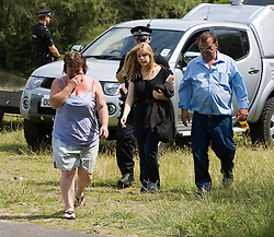 © licensed to London News Pictures. 15/07/2011. Maidenhead, UK. Family of Michael Payne at the scene.  Police divers from a search and rescue team searching Cookham Lock near Maidenhead, Berkshire today (15/07/2011) where 59 year-old Michael Payne went into the river trying to save his teenage daughter Zoe. Zoe was pulled to safety, but Mr Payne dissapeared beneath the surface , watched by his partner and two daughters. Photo credit should read Ben Cawthra/LNP