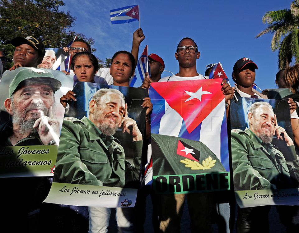 Cubans stand guard preventing access to the general public on the road to Cemeterio Santa Ifigenia in Santiago de Cuba on Sunday, December 4, 2016.