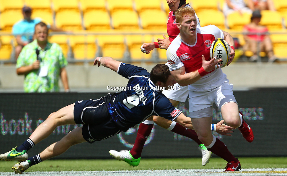 England's John Brake evades the tackle of Scotland's Scott Riddell. Hertz Wellington Sevens - Day Two at Westpac Stadium, Wellington, New Zealand on Saturday 2 February 2013. Photo: Justin Arthur / photosport.co.nz