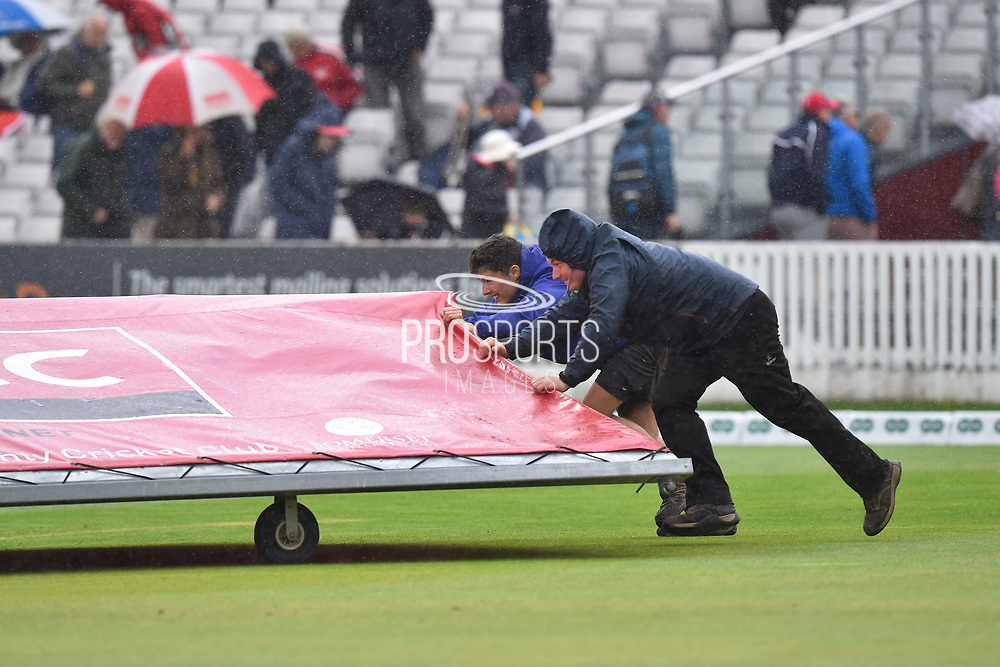 The covers are rushed on as rain stops play during the Specsavers County Champ Div 1 match between Somerset County Cricket Club and Essex County Cricket Club at the Cooper Associates County Ground, Taunton, United Kingdom on 26 September 2019.