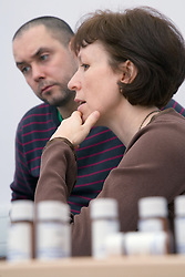 Homeopathic consultant discussing treatments with a patient,