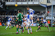 Bristol Rovers Midfielder, Chris Lines (14) heads clear a corner during the EFL Sky Bet League 1 match between Bristol Rovers and Scunthorpe United at the Memorial Stadium, Bristol, England on 25 February 2017. Photo by Adam Rivers.