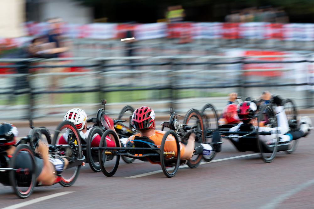 Slow shutter speed effect as riders cycle up The Mall in The Prudential RideLondon Handcycle Grand Prix. Saturday 28th July 2018<br /> <br /> Photo: Jed Leicester for Prudential RideLondon<br /> <br /> Prudential RideLondon is the world's greatest festival of cycling, involving 100,000+ cyclists - from Olympic champions to a free family fun ride - riding in events over closed roads in London and Surrey over the weekend of 28th and 29th July 2018<br /> <br /> See www.PrudentialRideLondon.co.uk for more.<br /> <br /> For further information: media@londonmarathonevents.co.uk