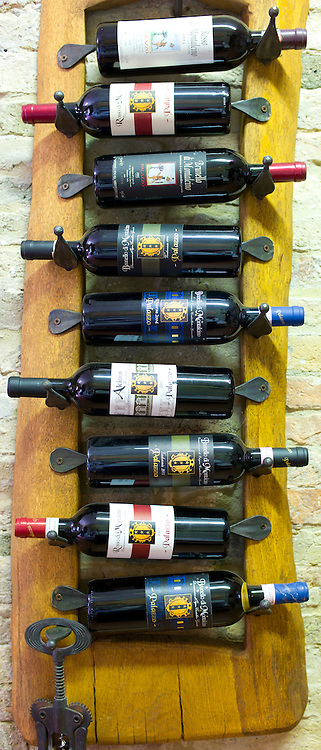 Brunello di Montalcino old vintage bottles of red wine at wine estate of Palazzo near Montalcino in Val D'Orcia, Tuscany, Italy