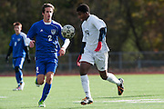 Burlington's Peter Makuni (14) and Mount Anthony's Thomas Hendrey (2) battle for the ball during the quarterfinal boys soccer game between Mount Anthony and Burlington at Buck Hard Field on Friday afternoon October 23, 2015 in Burlington. (BRIAN JENKINS/ for the FREE PRESS)