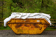 A yellow skip full of old bedding (duvets and pillows) outside the Youth Hostel Association  Helvellyn, The Lake District, United Kingdom. (photo by Andrew Aitchison / In pictures via Getty Images)