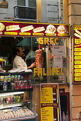 """Food vendors line the narrow back streets of St-Germain-des-Pres in Paris. Note the """"I love Egypt"""" sticker at top right."""